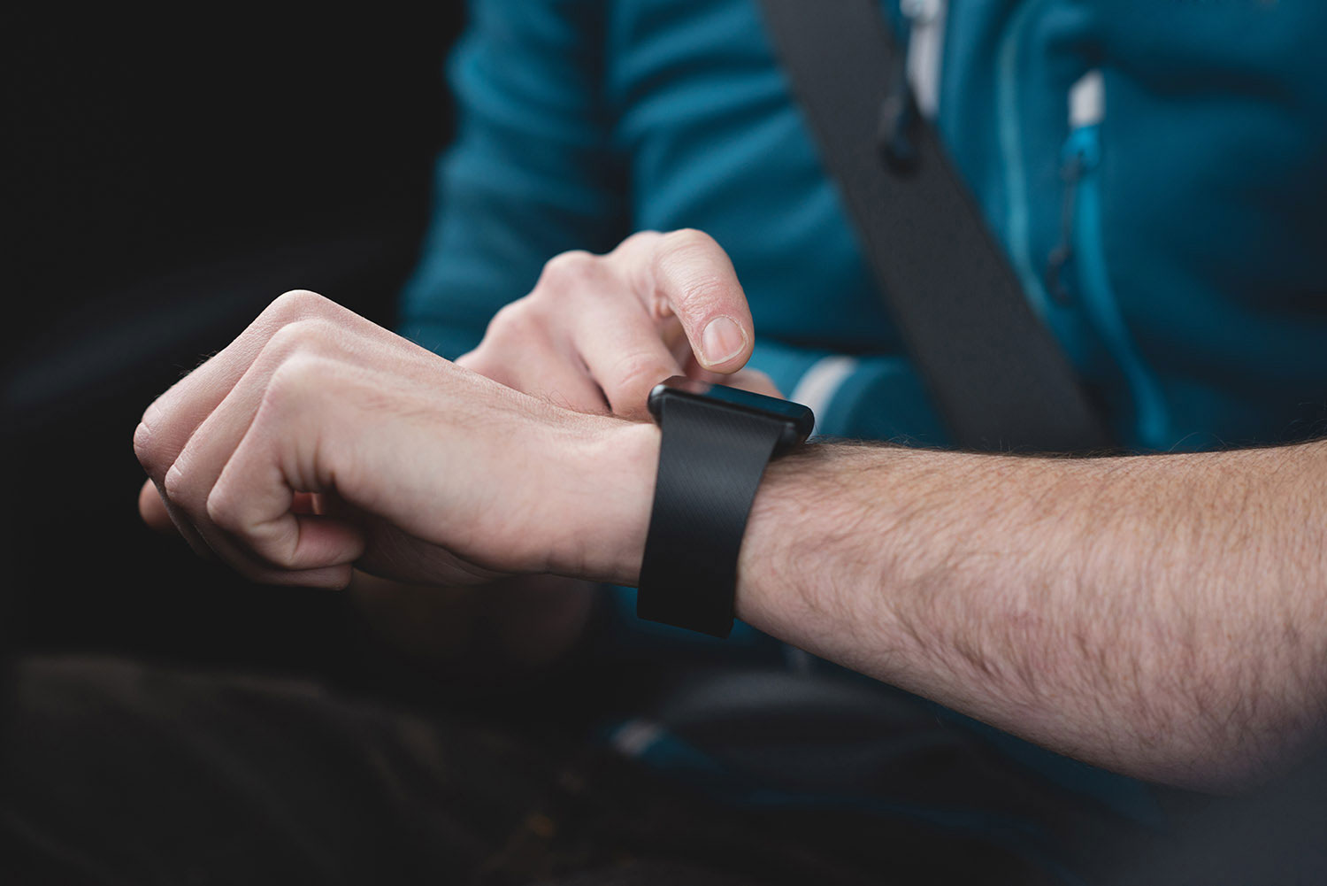 Man looks at smart watch